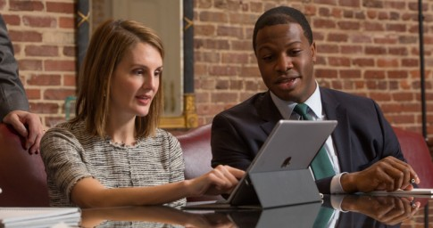 Two attorneys looking at an ipad