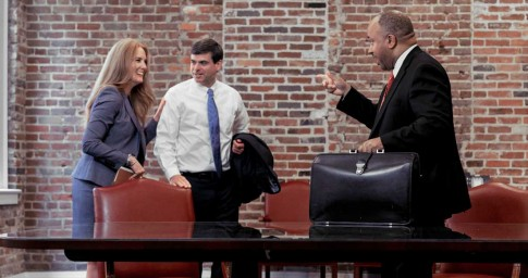 Three attorneys talking in a conference room