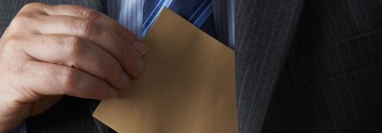 Man inserting envelop into jacket